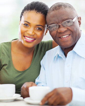 woman with elder man smiling
