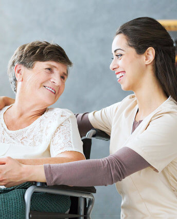 woman with caregiver smiling