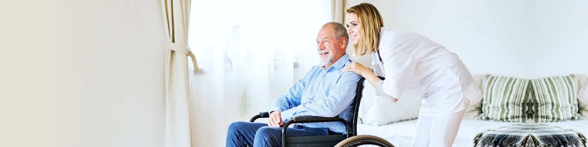 caregiver smiling with an elder man