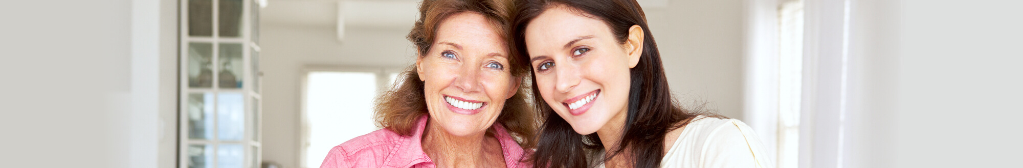 woman smiling with an elder woman